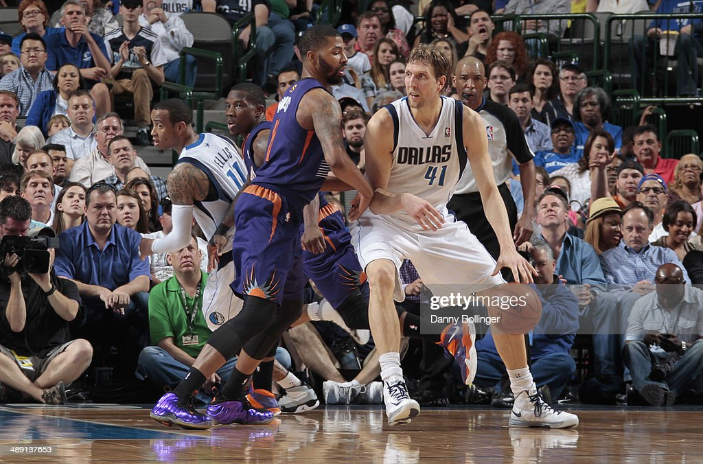 Dirk Nowitzki #41 of the Dallas Mavericks controls the ball against the Phoenix Suns on April 12, 2014 at the American Airlines Center in Dallas, Texas.