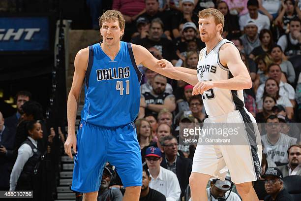 Dirk Nowitzki of the Dallas Mavericks defends the basket against Matt Bonner of the San Antonio Spursduring the game on October 28 2014 at the ATT...