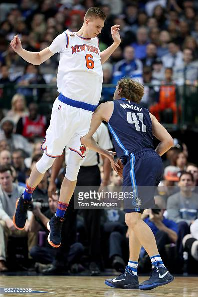 Dirk Nowitzki of the Dallas Mavericks draws a foul against Kristaps Porzingis of the New York Knicks in the first half at American Airlines Center on...