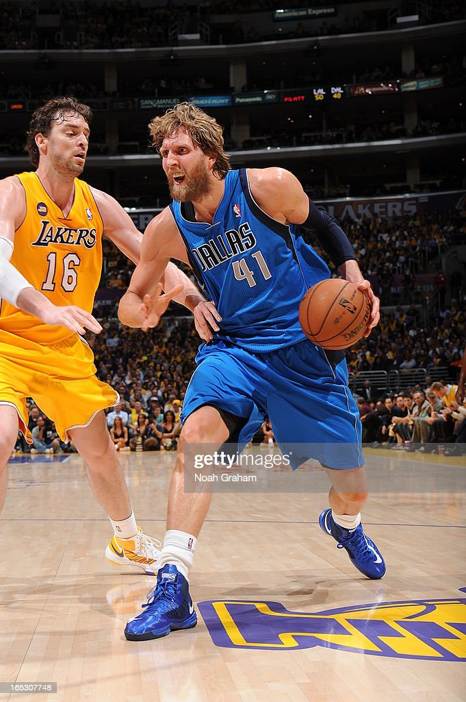 Dirk Nowitzki #41 of the Dallas Mavericks dribbles against Pau Gasol #16 of the Los Angeles Lakers at Staples Center on April 2, 2013 in Los Angeles, California.