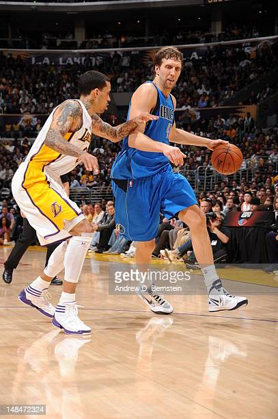 Dirk Nowitzki of the Dallas Mavericks dribbles the ball against Matt Barnes of the Los Angeles Lakers on April 15 2012 in Los Angeles California NOTE...