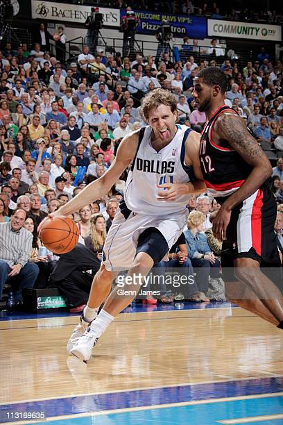 Dirk Nowitzki of the Dallas Mavericks drives against LaMarcus Aldridge of the Portland Trailblazers in Game Five of the Western Conference...