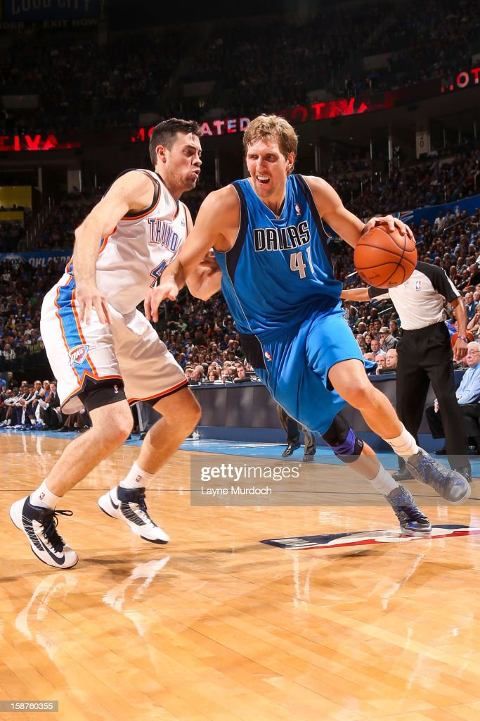Dirk Nowitzki #41 of the Dallas Mavericks drives against Nick Collison #4 of the Oklahoma City Thunder on December 27, 2012 at the Chesapeake Energy Arena in Oklahoma City, Oklahoma.