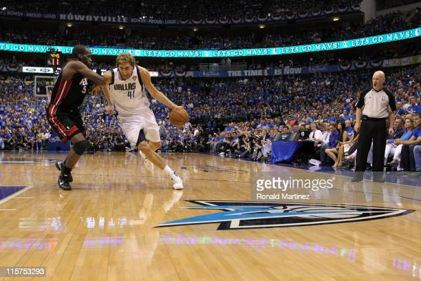 Dirk Nowitzki of the Dallas Mavericks drives on Joel Anthony of the Miami Heat in the second quarter in Game Five of the 2011 NBA Finals at American...