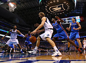 Dirk Nowitzki of the Dallas Mavericks drives on Serge Ibaka of the Oklahoma City Thunder in the first half in Game Five of the Western Conference...