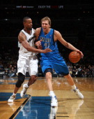 Dirk Nowitzki of the Dallas Mavericks drives to the basket against Rashard Lewis of the Washington Wizards during a game at the Verizon Center on...