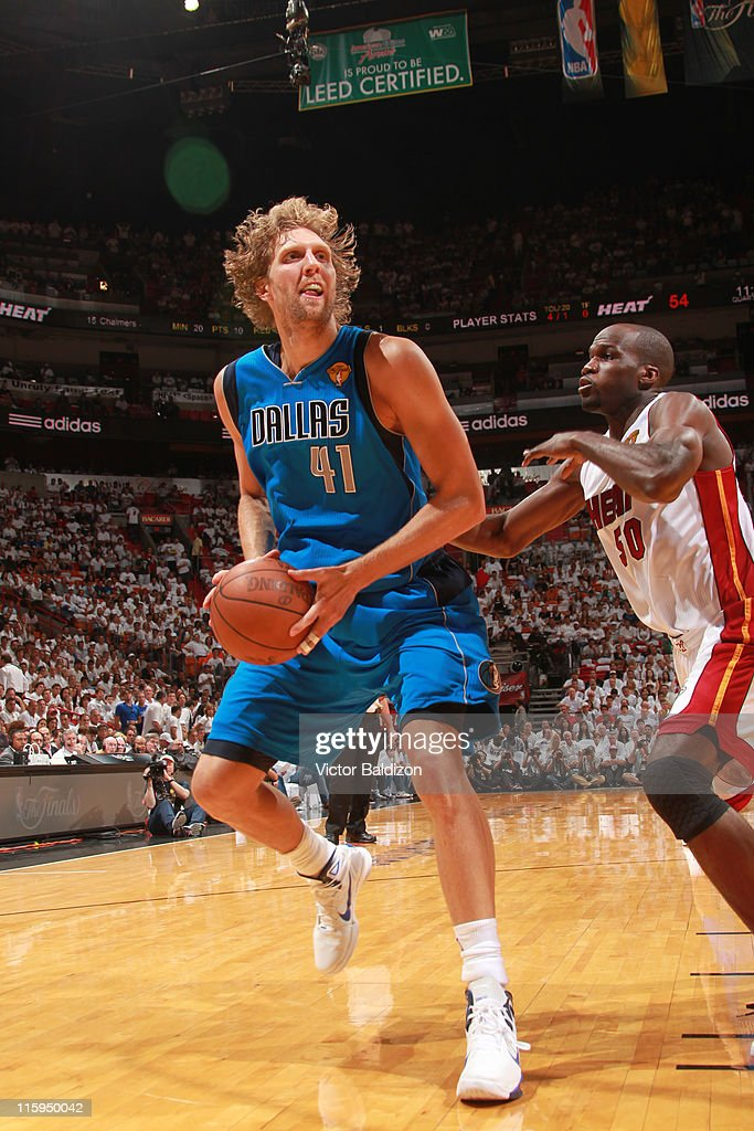 <a gi-track='captionPersonalityLinkClicked' href=/galleries/search?phrase=Dirk+Nowitzki&family=editorial&specificpeople=201490 ng-click='$event.stopPropagation()'>Dirk Nowitzki</a> #41 of the Dallas Mavericks drives to the basket against <a gi-track='captionPersonalityLinkClicked' href=/galleries/search?phrase=Joel+Anthony&family=editorial&specificpeople=4092295 ng-click='$event.stopPropagation()'>Joel Anthony</a> #50 of the Miami Heat during Game Six of the 2011 NBA Finals on June 12, 2011 at the American Airlines Arena in Miami, Florida.