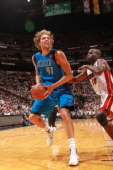 Dirk Nowitzki of the Dallas Mavericks drives to the basket against Joel Anthony of the Miami Heat during Game Six of the 2011 NBA Finals on June 12...