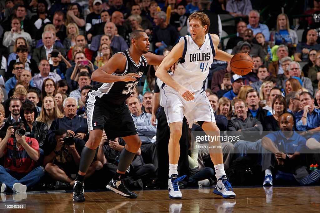 Dirk Nowitzki #41 of the Dallas Mavericks drives to the basket against the San Antonio Spurs on January 25, 2013 at the American Airlines Center in Dallas, Texas.