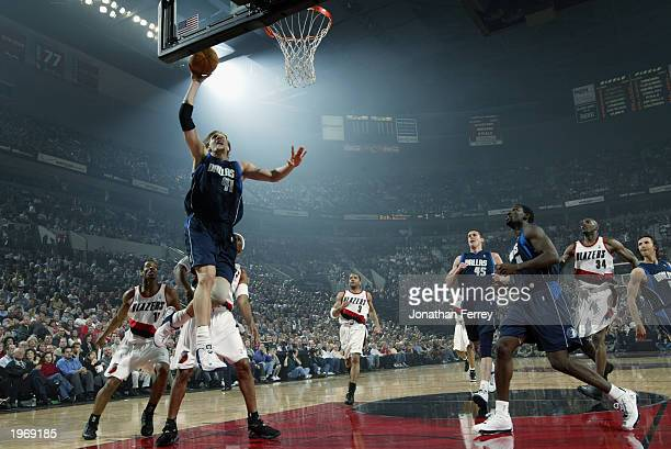 Dirk Nowitzki of the Dallas Mavericks drives to the basket against the Portland Trail Blazers in Game three of the Western Conference Quarterfinals...