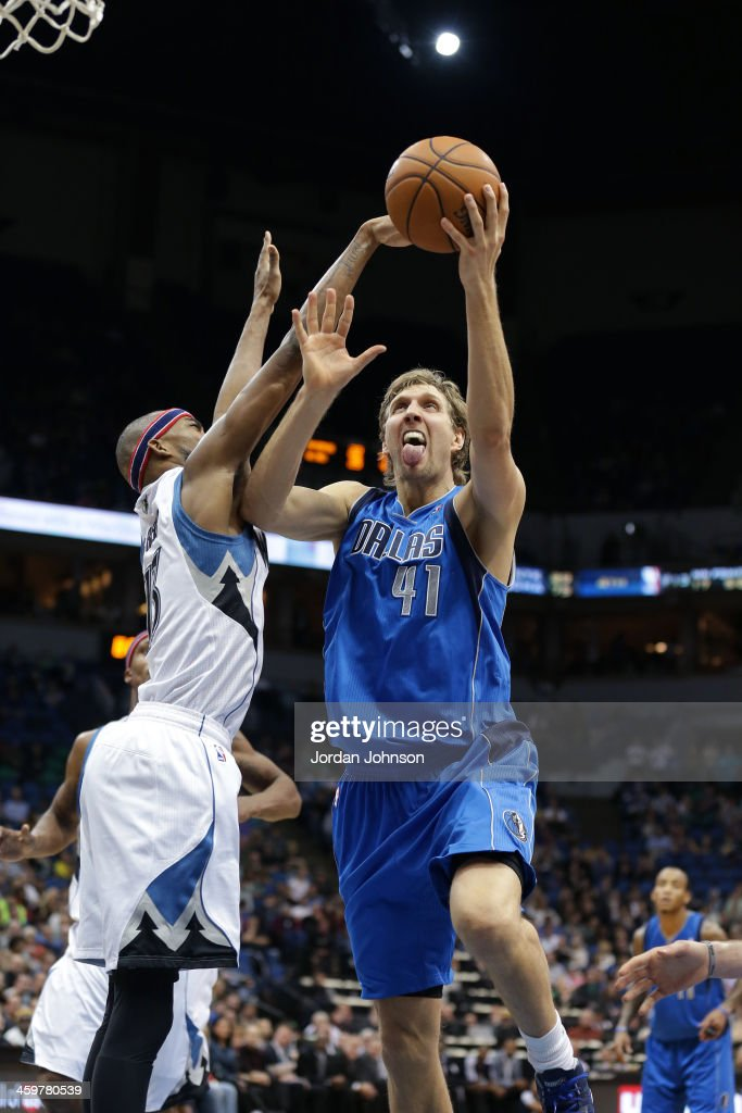 <a gi-track='captionPersonalityLinkClicked' href=/galleries/search?phrase=Dirk+Nowitzki&family=editorial&specificpeople=201490 ng-click='$event.stopPropagation()'>Dirk Nowitzki</a> #41 of the Dallas Mavericks drives to the basket against the Minnesota Timberwolves on November 8, 2013 at Target Center in Minneapolis, Minnesota.