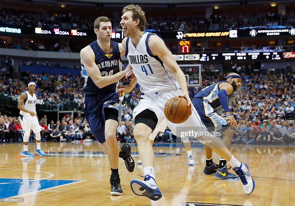 <a gi-track='captionPersonalityLinkClicked' href=/galleries/search?phrase=Dirk+Nowitzki&family=editorial&specificpeople=201490 ng-click='$event.stopPropagation()'>Dirk Nowitzki</a> #41 of the Dallas Mavericks drives to the basket against <a gi-track='captionPersonalityLinkClicked' href=/galleries/search?phrase=Jon+Leuer&family=editorial&specificpeople=4630766 ng-click='$event.stopPropagation()'>Jon Leuer</a> #30 of the Memphis Grizzlies in the first half at American Airlines Center on January 27, 2015 in Dallas, Texas.