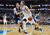 Dirk Nowitzki of the Dallas Mavericks drives to the basket against Jon Leuer of the Memphis Grizzlies in the first half at American Airlines Center...