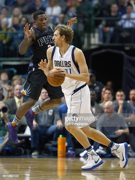 Dirk Nowitzki of the Dallas Mavericks drives to the basket against Eric Bledsoe of the Phoenix Suns in the second half at American Airlines Center on...