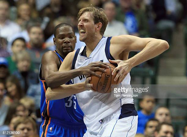 Dirk Nowitzki of the Dallas Mavericks drives to the basket against Kevin Durant of the Oklahoma City Thunder in the first half at American Airlines...