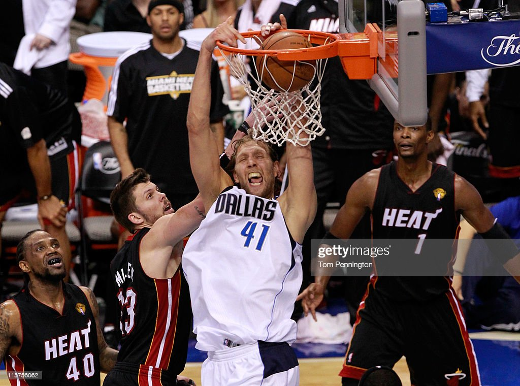 <a gi-track='captionPersonalityLinkClicked' href=/galleries/search?phrase=Dirk+Nowitzki&family=editorial&specificpeople=201490 ng-click='$event.stopPropagation()'>Dirk Nowitzki</a> #41 of the Dallas Mavericks dunks against <a gi-track='captionPersonalityLinkClicked' href=/galleries/search?phrase=Mike+Miller+-+Basketspelare&family=editorial&specificpeople=201801 ng-click='$event.stopPropagation()'>Mike Miller</a> #13 and <a gi-track='captionPersonalityLinkClicked' href=/galleries/search?phrase=LeBron+James&family=editorial&specificpeople=201474 ng-click='$event.stopPropagation()'>LeBron James</a> #6 of the Miami Heat late in the fourth quarter in Game Five of the 2011 NBA Finals at American Airlines Center on June 9, 2011 in Dallas, Texas.