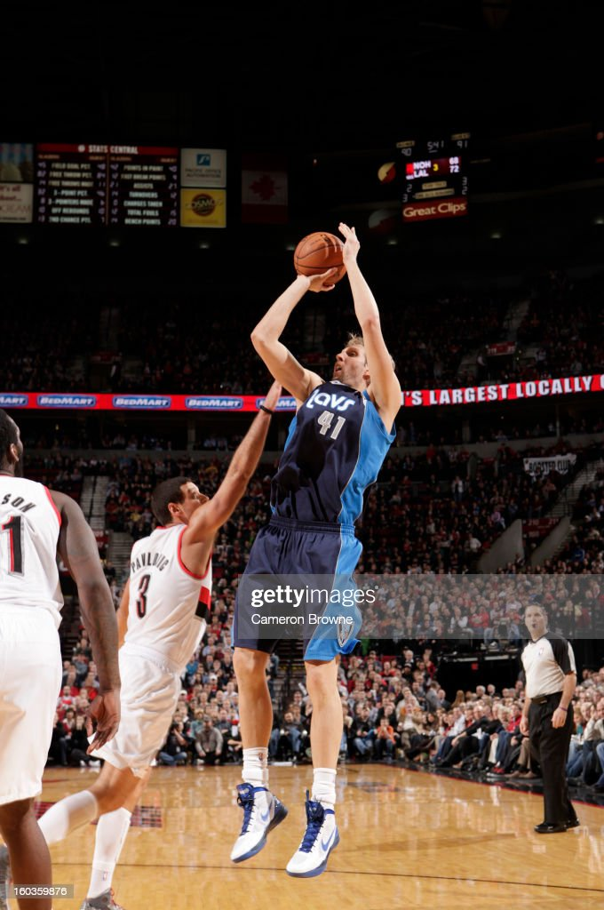 Dirk Nowitzki #41 of the Dallas Mavericks goes for a jump shot against Sasha Pavlovic #3 of the Portland Trail Blazers during the game between the Dallas Mavericks and the Portland Trail Blazers on January 29, 2013 at the Rose Garden Arena in Portland, Oregon.