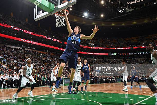 Dirk Nowitzki of the Dallas Mavericks goes for the layup against the Boston Celtics during the game on November 18 2015 at TD Garden in Boston...