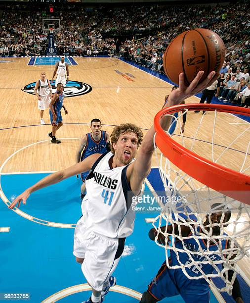 Dirk Nowitzki of the Dallas Mavericks goes in for the layup against Jeff Green of the Oklahoma City Thunder during a game at the American Airlines...