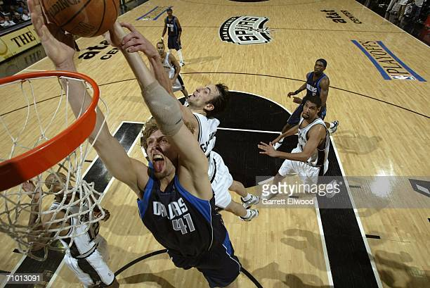 Dirk Nowitzki of the Dallas Mavericks goes to the basket against Manu Ginobili of the San Antonio Spurs in game seven of the Western Conference...