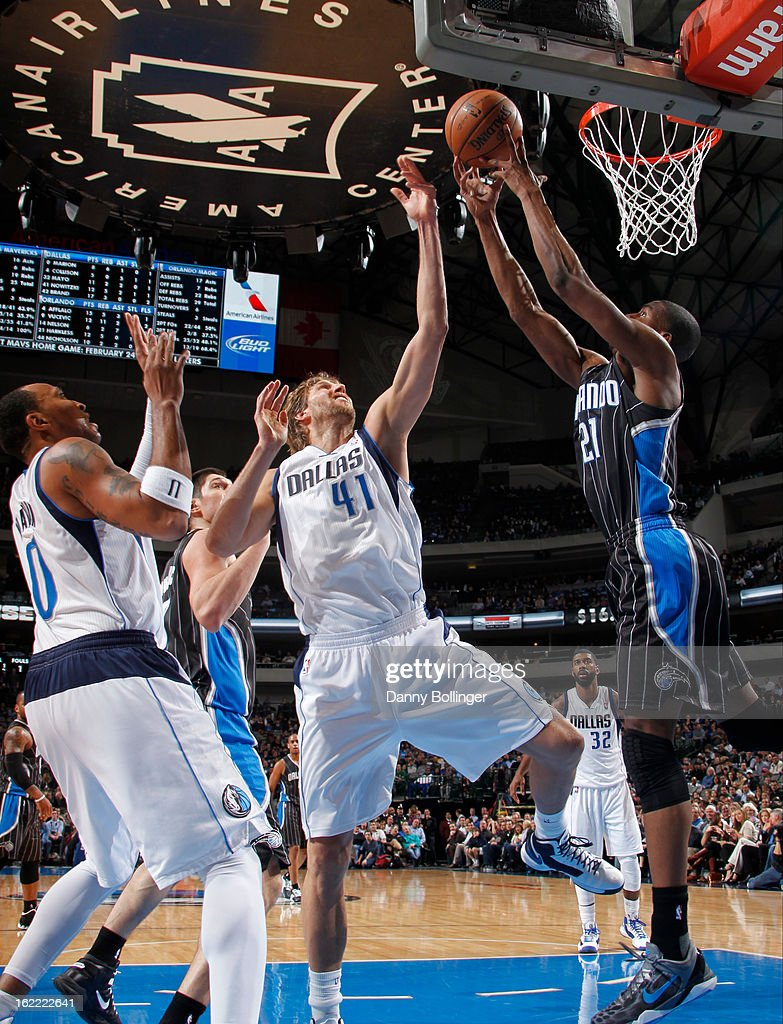 Dirk Nowitzki #41 of the Dallas Mavericks goes up for a rebound against Maurice Harkless #21 of the Orlando Magic on February 20, 2013 at the American Airlines Center in Dallas, Texas.