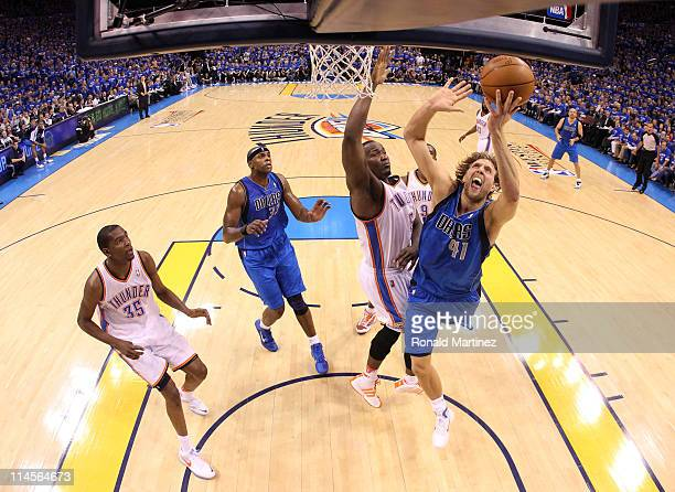 Dirk Nowitzki of the Dallas Mavericks goes up for a shot against Kendrick Perkins of the Oklahoma City Thunder in the first half in Game Four of the...