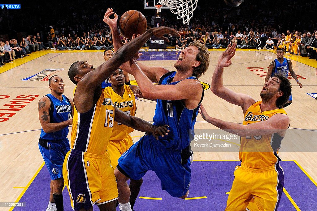 <a gi-track='captionPersonalityLinkClicked' href=/galleries/search?phrase=Dirk+Nowitzki&family=editorial&specificpeople=201490 ng-click='$event.stopPropagation()'>Dirk Nowitzki</a> #41 of the Dallas Mavericks goes up for a shot between <a gi-track='captionPersonalityLinkClicked' href=/galleries/search?phrase=Ron+Artest&family=editorial&specificpeople=201763 ng-click='$event.stopPropagation()'>Ron Artest</a> #15 and <a gi-track='captionPersonalityLinkClicked' href=/galleries/search?phrase=Pau+Gasol&family=editorial&specificpeople=201587 ng-click='$event.stopPropagation()'>Pau Gasol</a> #16 of the Los Angeles Lakers in the first quarter in Game Two of the Western Conference Semifinals in the 2011 NBA Playoffs at Staples Center on May 4, 2011 in Los Angeles, California.