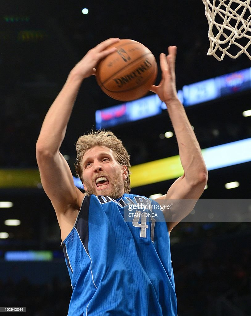 Dirk Nowitzki of the Dallas Mavericks grabs a rebound against the Brooklyn Nets at the Barclays Center March 1, 2013 in the Brooklyn borough of New York. The Mavericks won, 98-90. AFP PHOTO/Stan HONDA