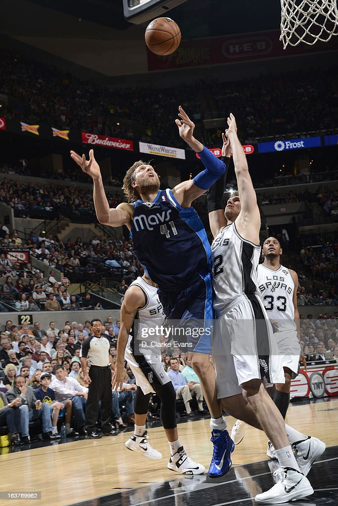 <a gi-track='captionPersonalityLinkClicked' href=/galleries/search?phrase=Dirk+Nowitzki&family=editorial&specificpeople=201490 ng-click='$event.stopPropagation()'>Dirk Nowitzki</a> #41 of the Dallas Mavericks grabs the loose ball against <a gi-track='captionPersonalityLinkClicked' href=/galleries/search?phrase=Tiago+Splitter&family=editorial&specificpeople=208218 ng-click='$event.stopPropagation()'>Tiago Splitter</a> #22 of the San Antonio Spurs on March 14, 2013 at the AT&T Center in San Antonio, Texas.