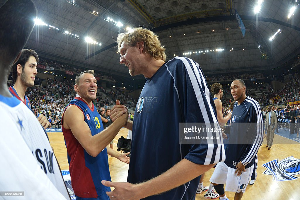 <a gi-track='captionPersonalityLinkClicked' href=/galleries/search?phrase=Dirk+Nowitzki&family=editorial&specificpeople=201490 ng-click='$event.stopPropagation()'>Dirk Nowitzki</a> #41 of the Dallas Mavericks greets <a gi-track='captionPersonalityLinkClicked' href=/galleries/search?phrase=Sarunas+Jasikevicius&family=editorial&specificpeople=581779 ng-click='$event.stopPropagation()'>Sarunas Jasikevicius</a> #13 of F.C. Barcelona Regal during the game at Palau St. Jordi for NBA Europe Live 2012 on October 9, 2012 in Barcelona, Spain.