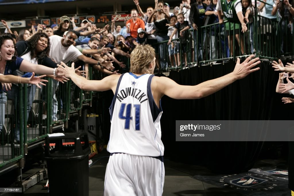 Dirk Nowitzki of the Dallas Mavericks greets the fans after a victory against the Dallas Mavericks Blue Team in a team scrimmage during the team's...