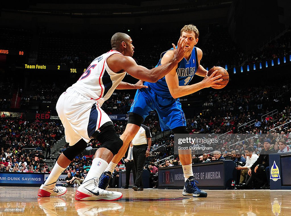 <a gi-track='captionPersonalityLinkClicked' href=/galleries/search?phrase=Dirk+Nowitzki&family=editorial&specificpeople=201490 ng-click='$event.stopPropagation()'>Dirk Nowitzki</a> #41 of the Dallas Mavericks handles the ball against <a gi-track='captionPersonalityLinkClicked' href=/galleries/search?phrase=Al+Horford&family=editorial&specificpeople=699030 ng-click='$event.stopPropagation()'>Al Horford</a> #15 of the Atlanta Hawks on November 29, 2013 at Philips Arena in Atlanta, Georgia.