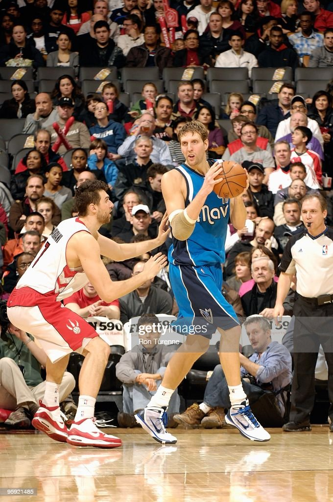 Dirk Nowitzki #41 of the Dallas Mavericks handles the ball against Andrea Bargnani #7 of the Toronto Raptors during the game on January 17, 2010 at Air Canada Centre in Toronto, Canada. The Raptors won 110-88.