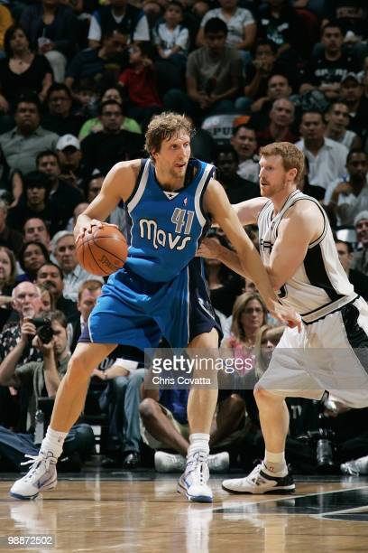 Dirk Nowitzki of the Dallas Mavericks handles the ball against Matt Bonner of the San Antonio Spurs in Game Three of the Western Conference...