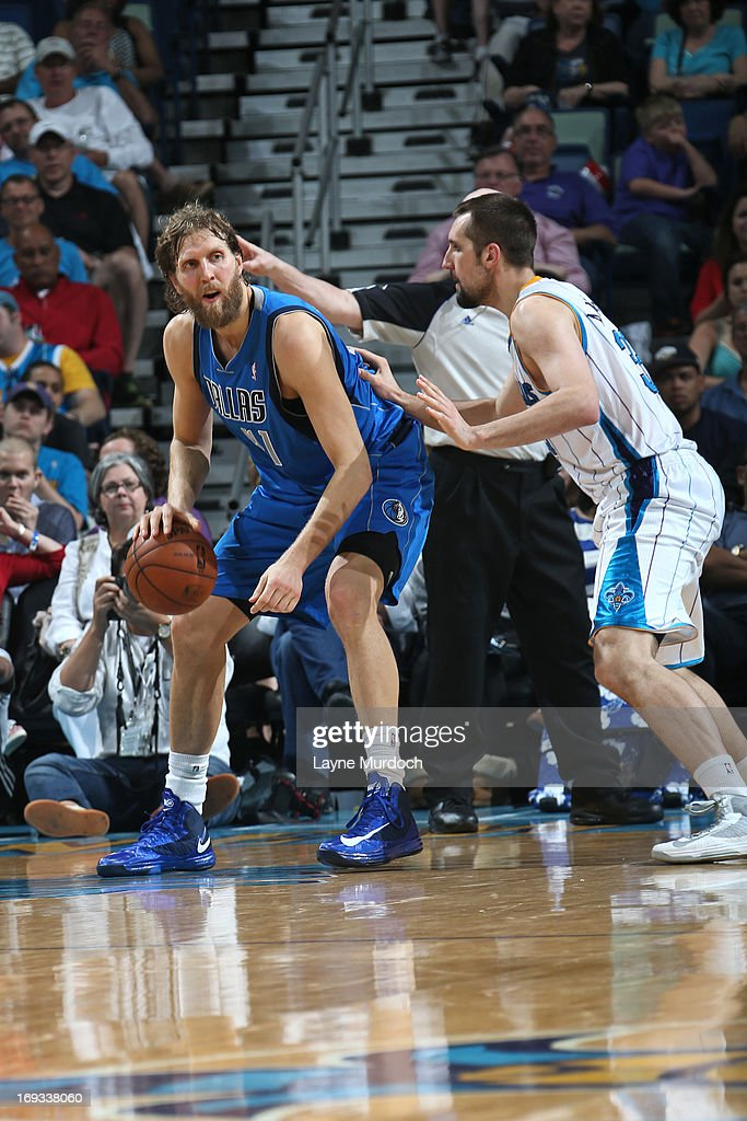 <a gi-track='captionPersonalityLinkClicked' href=/galleries/search?phrase=Dirk+Nowitzki&family=editorial&specificpeople=201490 ng-click='$event.stopPropagation()'>Dirk Nowitzki</a> #41 of the Dallas Mavericks handles the ball against Ryan Anderson #33 of the New Orleans Hornets on April 14, 2013 at the New Orleans Arena in New Orleans, Louisiana.