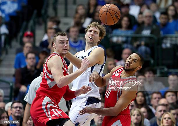 Dirk Nowitzki of the Dallas Mavericks has a shot blocked by Sam Dekker of the Houston Rockets and Clint Capela of the Houston Rockets in the first...