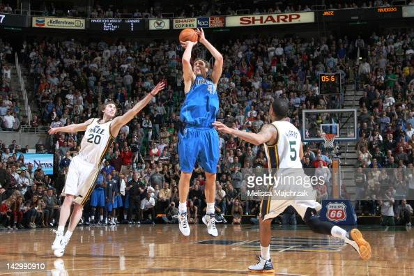 Dirk Nowitzki of the Dallas Mavericks hits the 3 point shot over the Utah Jazz to send the game into double overtime at Energy Solutions Arena on...