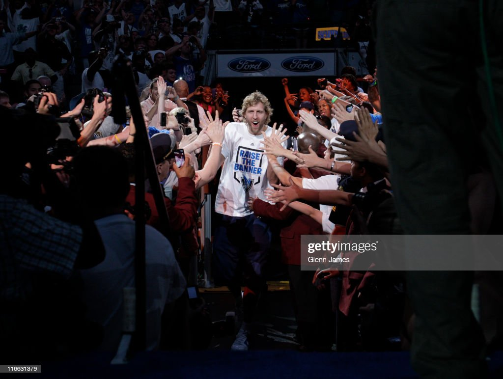 <a gi-track='captionPersonalityLinkClicked' href=/galleries/search?phrase=Dirk+Nowitzki&family=editorial&specificpeople=201490 ng-click='$event.stopPropagation()'>Dirk Nowitzki</a> of the Dallas Mavericks is introduced to the crowd during the Mavericks NBA Champion Victory Parade on June 16, 2011 at the American Airlines Center in Dallas, Texas.