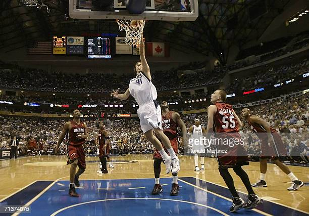 Dirk Nowitzki of the Dallas Mavericks lays a shot up over Udonis Haslem Jason Williams and Shaquille O'Neal of the Miami Heat in the second quarter...