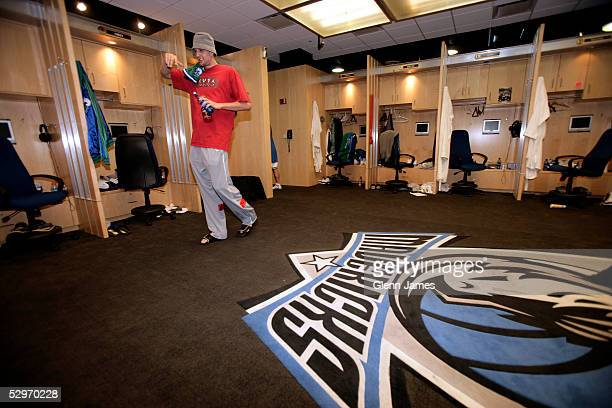 Dirk Nowitzki of the Dallas Mavericks leaves the locker room at the American Airlines Center on May 23 2005 in Dallas Texas NOTE TO USER User...