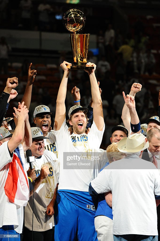 Dirk Nowitzki #41 of the Dallas Mavericks lifts the Larry O'Brien Trophy in celebration after defeating the Miami Heat in Game Six of the 2011 NBA Finals on June 12, 2011 at the American Airlines Arena in Miami, Florida.