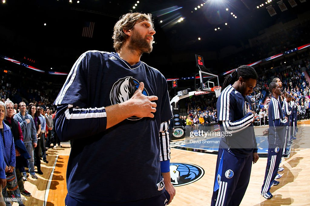 Dirk Nowitzki #41 of the Dallas Mavericks listens to the National Anthem before playing against the Minnesota Timberwolves on March 10, 2013 at Target Center in Minneapolis, Minnesota.