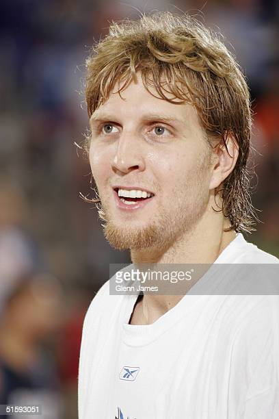 Dirk Nowitzki of the Dallas Mavericks looks on prior during an intrasquad exhibition at the Mavs Fan Jam on October 9 2004 at Texas Christian...