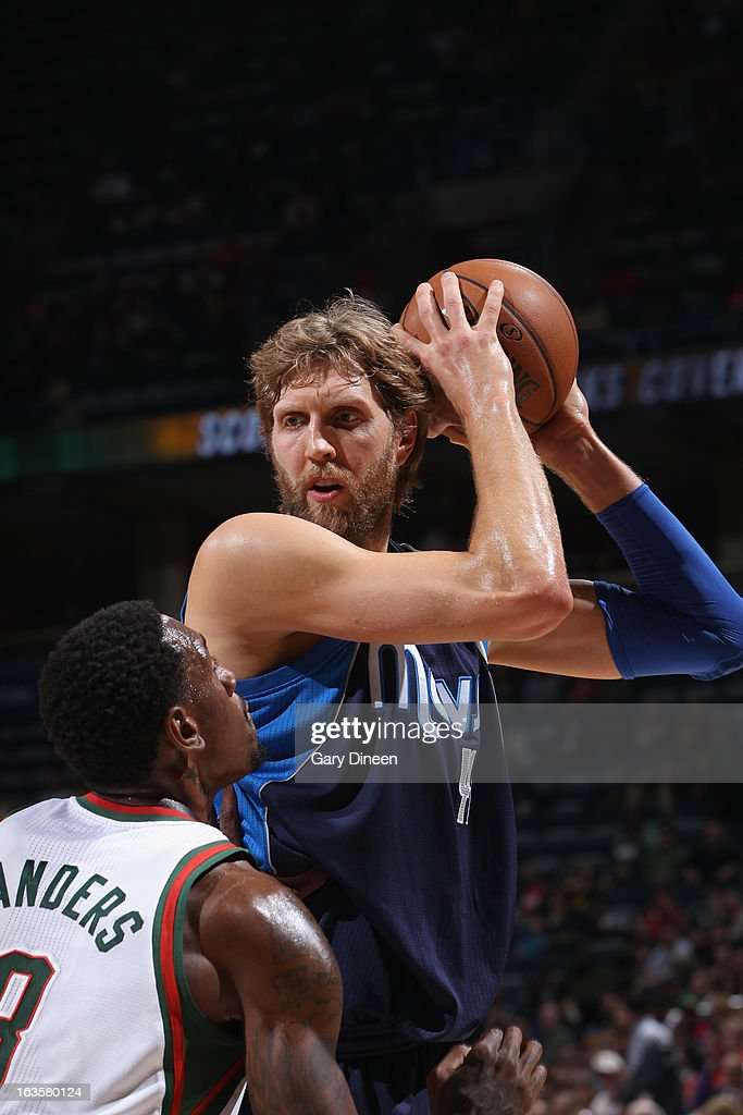 Dirk Nowitzki #41 of the Dallas Mavericks looks to drive against Larry Sanders #8 of the Milwaukee Bucks on March 12, 2013 at the BMO Harris Bradley Center in Milwaukee, Wisconsin.