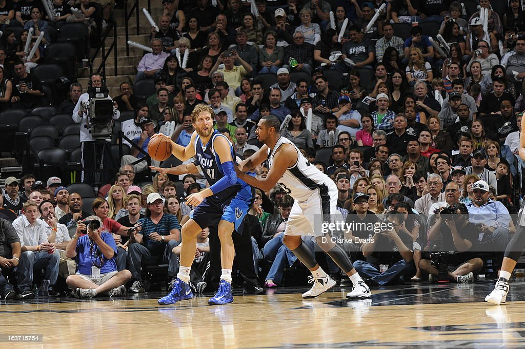 Dirk Nowitzki #41 of the Dallas Mavericks looks to pass the ball against the San Antonio Spurs on March 14, 2013 at the AT&T Center in San Antonio, Texas.