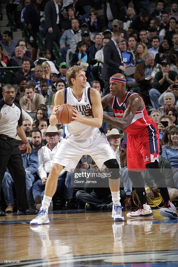 Dirk Nowitzki #41 of the Dallas Mavericks looks to pass the ball against Al Harrington #7 of the Washington Wizards on November 12, 2013 at the American Airlines Center in Dallas, Texas.