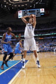 Dirk Nowitzki of the Dallas Mavericks looks to shoot over Kevin Durant of the Oklahoma City Thunder during the game between the Dallas Mavericks and...