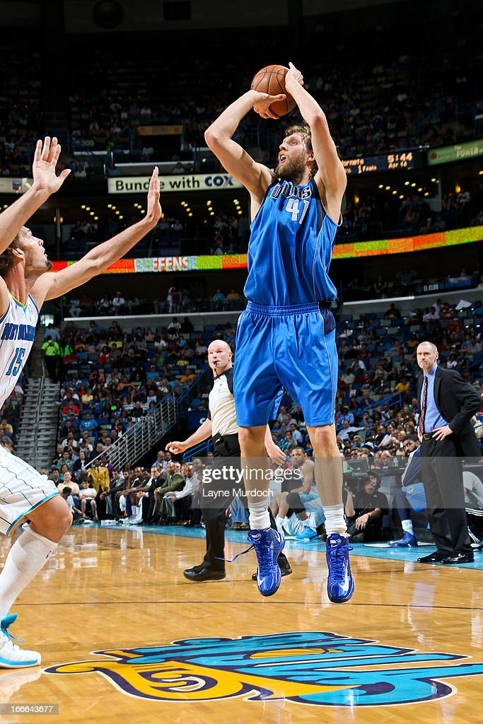 <a gi-track='captionPersonalityLinkClicked' href=/galleries/search?phrase=Dirk+Nowitzki&family=editorial&specificpeople=201490 ng-click='$event.stopPropagation()'>Dirk Nowitzki</a> #41 of the Dallas Mavericks makes a shot, passing the 25,000 point career milestone, against <a gi-track='captionPersonalityLinkClicked' href=/galleries/search?phrase=Robin+Lopez&family=editorial&specificpeople=2351509 ng-click='$event.stopPropagation()'>Robin Lopez</a> #15 of the New Orleans Hornets during their game on April 14, 2013 at the New Orleans Arena in New Orleans, Louisiana.