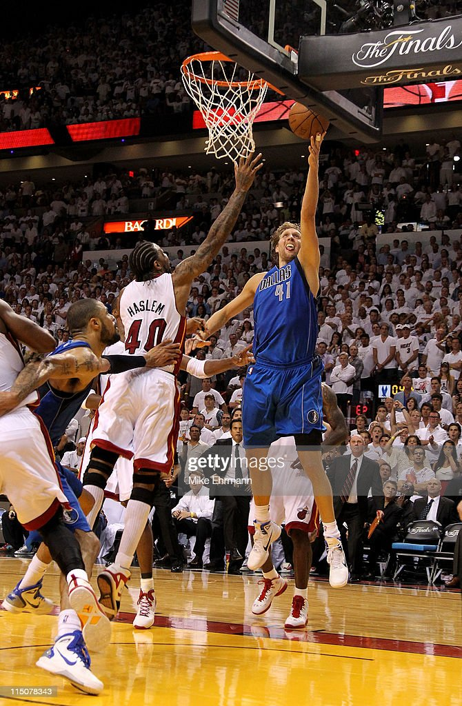 <a gi-track='captionPersonalityLinkClicked' href=/galleries/search?phrase=Dirk+Nowitzki&family=editorial&specificpeople=201490 ng-click='$event.stopPropagation()'>Dirk Nowitzki</a> #41 of the Dallas Mavericks makes the game-winning shot to put the Mavericks up 95-93 with 3.6 seconds left in the game against <a gi-track='captionPersonalityLinkClicked' href=/galleries/search?phrase=Udonis+Haslem&family=editorial&specificpeople=201748 ng-click='$event.stopPropagation()'>Udonis Haslem</a> #40 of the Miami Heat in Game Two of the 2011 NBA Finals at American Airlines Arena on June 2, 2011 in Miami, Florida.