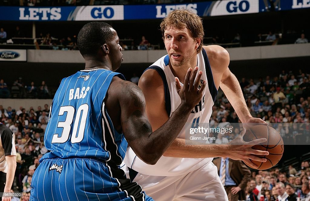Dirk Nowitzki #41 of the Dallas Mavericks moves the ball against Brandon Bass #30 of the Orlando Magic during the game on April 1, 2010 at American Airlines Center in Dallas, Texas. The Magic won 97-82.